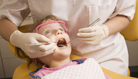 Фото: лечение кариеса у ребенка