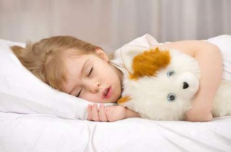 Фото: ребенок скрипит зубами во сне