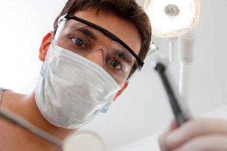 Фото: лечение больного зуба под коронкой