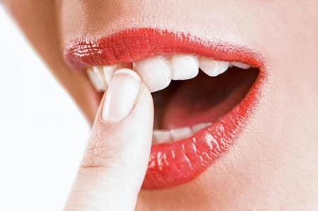 Фото: что делать если шатается зуб